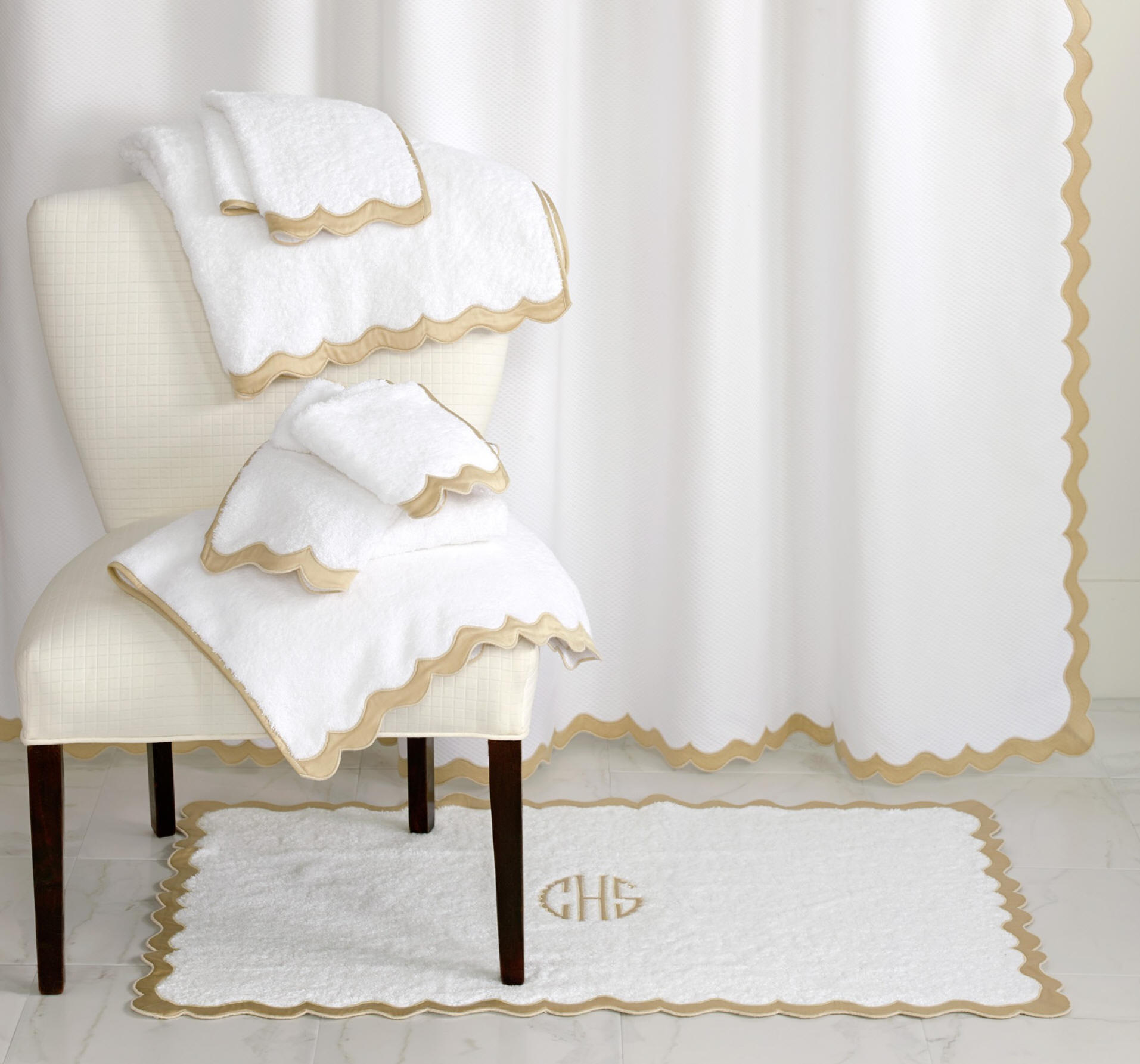 Luxury Egyptian cotton bath towels, bath sheets, and shower curtains finished with an applique scallop border and custom monogram.