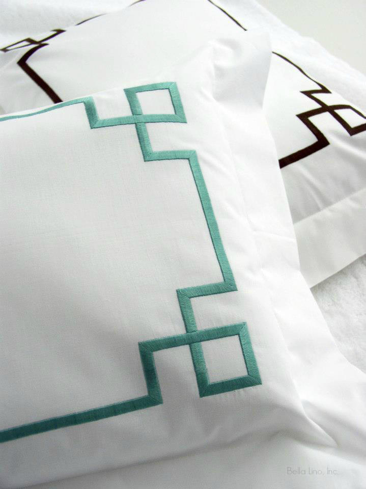 Embroidered geometric Fretwork design on luxury duvet covers, shams, sheets and pique bed linens.