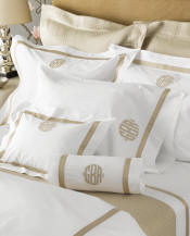 "Lowell luxury sheeting with applied 1"" band and applique monogram."