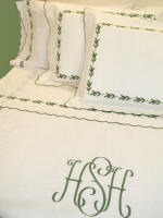 Couture bed linens with monograms and embroidery on luxury linens, sheets, coverlets and shams.