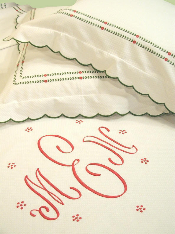 Luxury bed linens with intricate embroidery and custom monogramming.