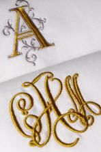 Our Signature Monograms available on fine linens, luxury table linens, and as monogrammed linen guest towels.