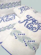 Custom embroidered Leaf & Dot bath towels with custom binding.